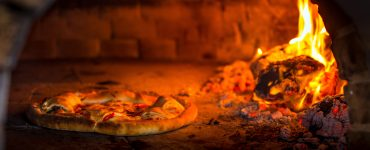 pizza in a brick oven